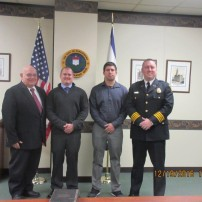Fire department swears in two new officers.